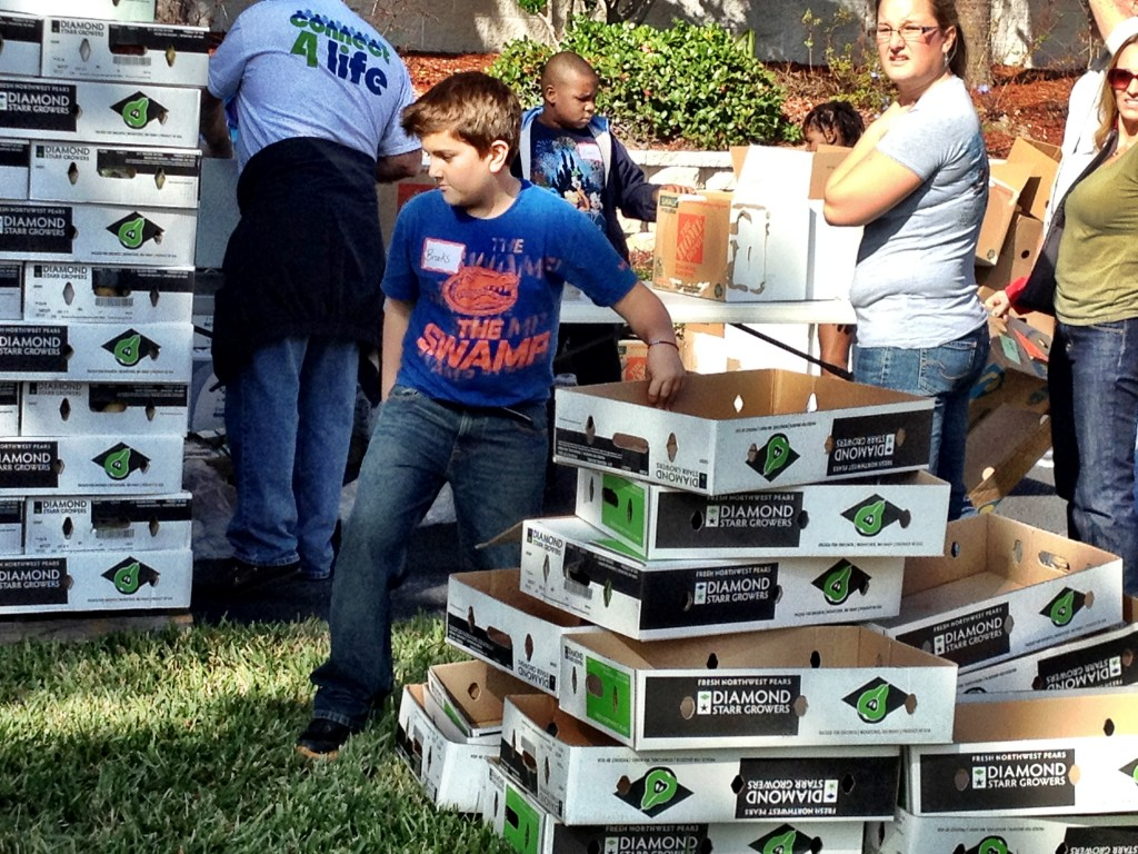"Brooks moves boxes in his University of Florida ""swamp"" shirt."