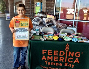 Brooks raised $96 in two hours at Winn Dixie in Madeira Beach.  That provides 672 meals!