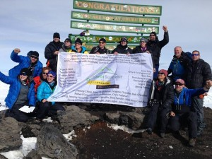 Dr. Robert Masson (top row, second from the right) with Wendy Chioji and Marc Middleton at Survivor's Summit (Mt. Kilimanjaro) via the Livestrong Foundation.